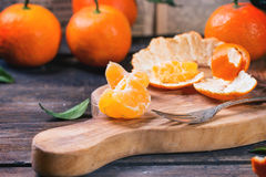 Tangerines on cutting board Stock Photography