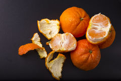 Tangerines on dark background Royalty Free Stock Images