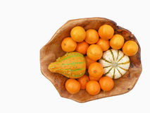 Tangerines and decorative pumpkins. In wooden bowl isolated on white background Royalty Free Stock Photos
