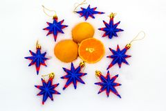 Tangerines and decorative stars on snow Royalty Free Stock Image