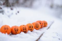Tangerines with different funny facial expressions Royalty Free Stock Photography