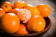 Tangerines in dish on wooden table Royalty Free Stock Image