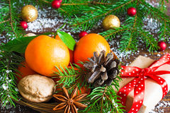 Tangerines, fir tree, pine cones and nuts. Christmas food decorations Stock Images