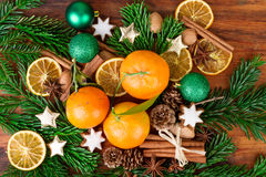 Tangerines fruits christmas decoration with fir branch and spices Stock Photo