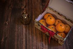 Tangerines in a gift box, new year mood, festive table decoration royalty free stock photos