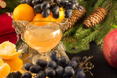 Tangerines and a glass of sparkling wine. For a festive new year's table Royalty Free Stock Images