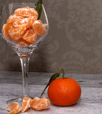 Tangerines in a glass vase Stock Image