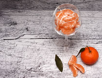 Tangerines in a glass vase Stock Photos