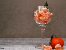 Tangerines in a glass vase Stock Photography