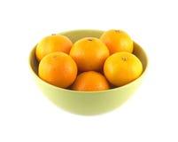Tangerines in green china bowl isolated. Orange tangerines inside green china bowl isolated over white closeup stock image