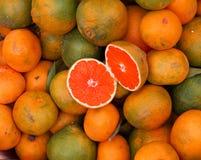Tangerines with green Peel Stock Photo