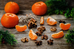 Tangerines and ingredients for baking. On a dark wood background. tinting. selective focus Stock Photo