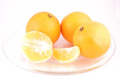 Tangerines isolated. Tangerines on the plate isolated on the white background Royalty Free Stock Photos