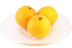 Tangerines isolated with path. Tangerines on a plate isolated saved with clipping path royalty free stock photos