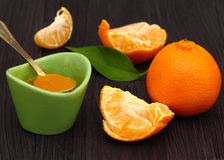 Tangerines and  jam in glass jar Stock Images