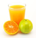Tangerines and juice Stock Photos