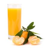 Tangerines and juice glass Stock Photos
