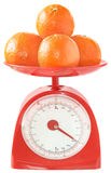 Tangerines on kitchen scales. Stock Photo