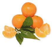 Tangerines with leaves and slices. Tangerines with green leaf and slices Royalty Free Stock Photos