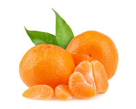 Tangerines with leaves and slices on white background.  Royalty Free Stock Image