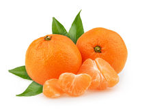 Tangerines with leaves and slices on white background Stock Photo