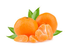 Tangerines with leaves and slices on white background Stock Photography