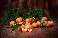 Tangerines with leaves on wooden surface. Citrus fruit Royalty Free Stock Image