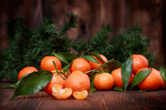 Tangerines with leaves on wooden surface. Citrus fruit Royalty Free Stock Photos
