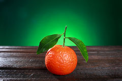 Tangerines with leaves on wooden surface. Citrus fruit Stock Photography
