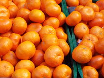 Tangerines. Lie in boxes on display in a market stand Royalty Free Stock Photos