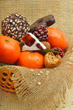 Tangerines, lokum, pinecone and brittle candies on christmas sac Royalty Free Stock Photo