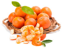 Tangerines or mandarin with leaves and slices Stock Images