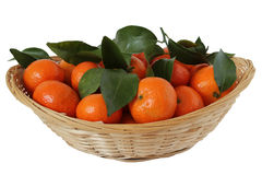 Tangerines  mandarin  with leaves in a straw cup Royalty Free Stock Image