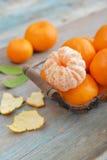Tangerines in metal basket Stock Photography