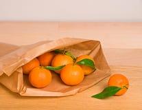 Tangerines in paper bag Stock Photo