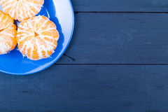 The tangerines peeled in a blue plate Royalty Free Stock Photo