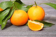Tangerines, peeled tangerine and tangerine slices Royalty Free Stock Images