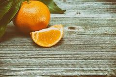 Tangerines, peeled tangerine and tangerine slices Stock Photo