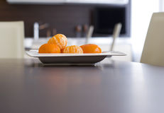 Tangerines on a plate. Tangerines on a modern plate Royalty Free Stock Photos