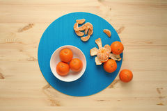 Tangerines on a plate. Fresh fruit Royalty Free Stock Photos