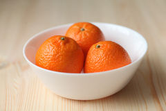 Tangerines on a plate. Fresh fruit Stock Photos