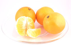 Tangerines in plate isolated. Tangerines in the plate isolated on white background royalty free stock image