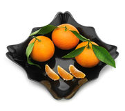 Tangerines in a plate Stock Images