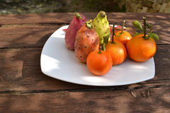Tangerines with prickly pears Royalty Free Stock Images