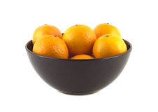 Tangerines in purple china bowl isolated. Orange tangerines inside purple china bowl isolated over white closeup royalty free stock photos