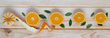 Tangerines ranked. Tangerines laid out in a line on a wooden table Stock Photo