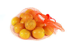 Tangerines in red plastic net. Isolated on white background Royalty Free Stock Image