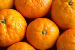 Tangerines. Rind fresh raw tangerines closeup background texture stock images