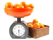 Tangerines on scales and in a box Royalty Free Stock Photo