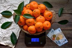 Tangerines on scales in shop Royalty Free Stock Photography